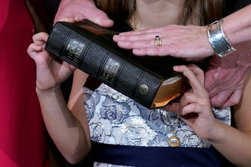 Rep. Madeleine Dean (D-PA) poses with a Bible for a ceremonial swearing-in picture on Capitol Hill in Washington