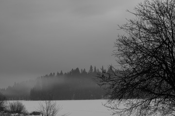 Evening Fog Forms Over Frozen Lake