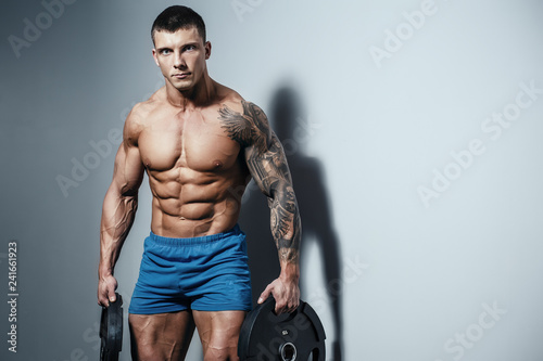 Muscular man bodybuilder training in gym and posing  Fit