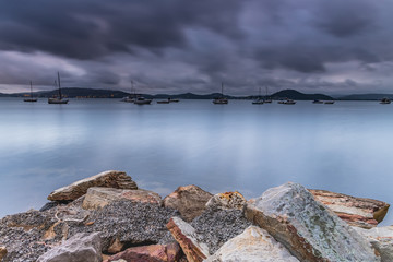 Overcast and Cloudy Bay with Boats