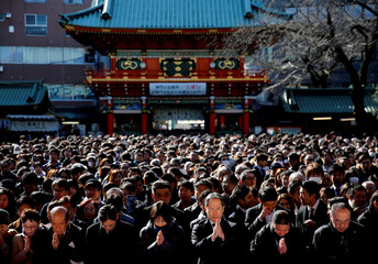 People offer prayers on the first business day of the year at the Kanda Myojin shrine, which is known to be frequented by worshippers seeking good luck and prosperous business, in Tokyo