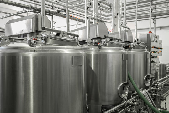 storage and pasteurization tank at the milk factory. equipment at the dairy plant