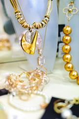 Assortment of jewelry in shop. Close-up view