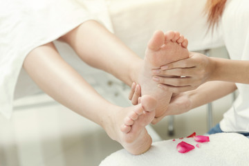 women foot massage feet therapy in spa relax and gentle white clean tone.