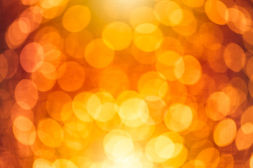 blur bokeh of orange warm light abstract for background.