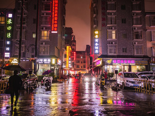 zhangjiajie/China - 13 October 2018:Beautiful city of Zhangjiajie city in the night with the rain in holiday time.sightseeing Building in the night time of zhangjiajie City china Fotomurales
