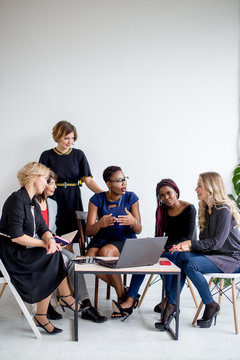 Female confidence and cheerful leadership from african american woman in group meeting of small business partners, multi level marketing concept