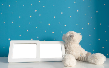 picture frame and teddy bear