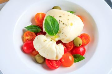 Traditional italian food - white ball mozzarella,tomato, basil, olive