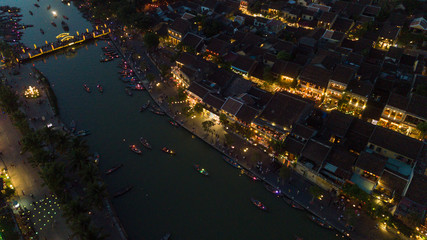 Aerial view of Hoi An old town or Hoian ancient town in night. Royalty high-quality free stock video footage top view of Hoai river and boat traffic Hoi An. Hoi An street and river in night with light