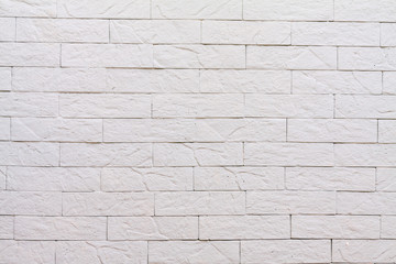 Background rough brick wall painted with white paint