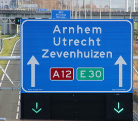 Green arrow above the driving lane indicating that its open on motorway A12 E30 heading Arnhem, utrecht and Zevenhuizen