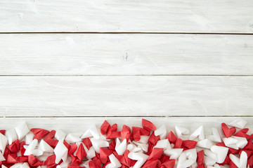 White and red  paper heart on wooden