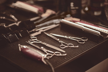 Professional tools of hairdresser in red case. Tools for cutting beard and hair barbershop..