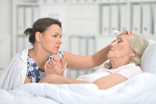 Portrait of young woman visiting sick mother