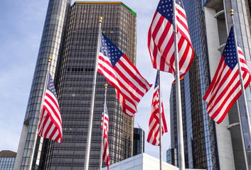 The Renaissance Center (RenCen) skyscrapers surrounded by American Flags in Downtown Detroit, Michigan, USA