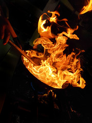 the silhouette of the flames whilst a chef flambéing in a local kitchen in Puerto Banus, Spain