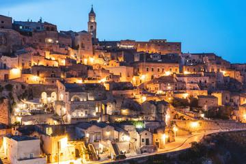 Italy, Basilicata, Matera, Townscape and historical cave dwelling, Sassi di Matera at blue hour