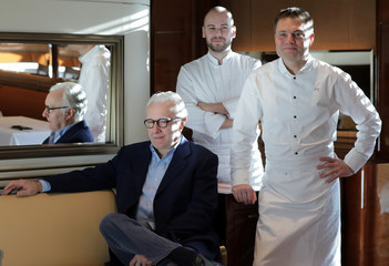"""French Chef Alain Ducasse poses in his new restaurant """"Omer"""" with Chef Patrick Laine and pastry Chef Dorian Lutzelschwab at the Hotel de Paris in Monte-Carlo"""