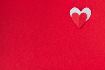 background for Valentine's day and eighth of March, red heart on red background