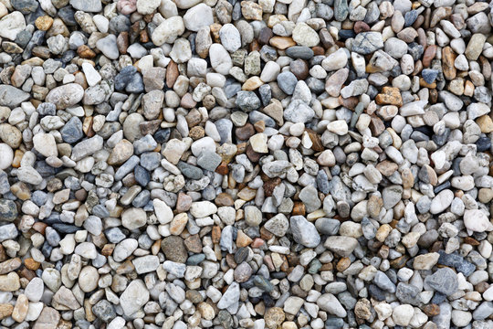 Close-up texture of colorful sea pebbles. Small Rock. Sea background