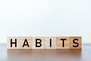 Habits word written on wooden cubes