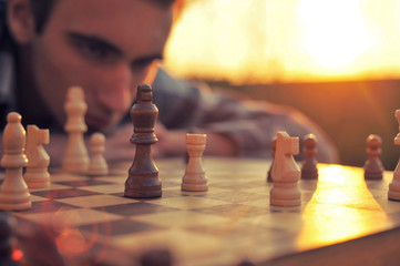 Man looks at a chessboard