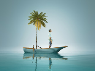 Young man and a palm tree standing in a boat, in the middle of ocean