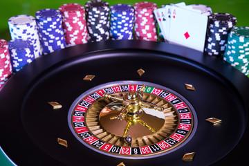 Poker Chips, Roulette wheel in motion, casino background