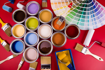 Can with paint and paintbrush, red background