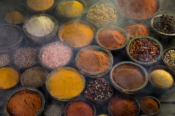 Aromatic spices, smoke and Still Life background