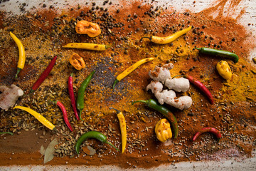 Aromatic spices on wooden background