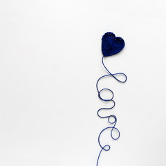 Creative concept. Kate and Love word from blue knitting yarn on white wooden background. Flat lay. Top view. Valentines day celebration