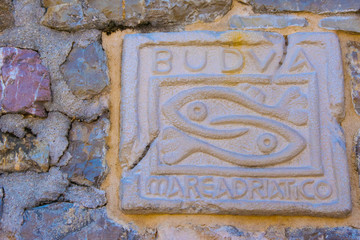 Two fish catching each other by the tail -historical symbol of the city of Budva, Montenegro.