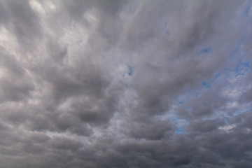 The sky covered with gray, heavy clouds.