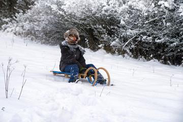 Boy sitting on a sled