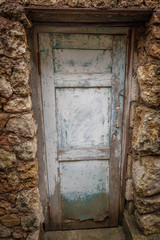 Old wooden door in a stone old house