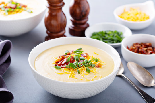 Potato cream soup with bacon, green onion and cheese
