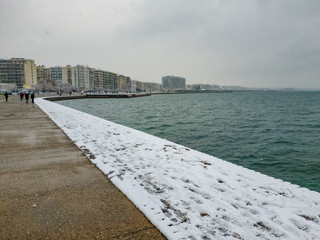 Thessaloniki, Greece heavy snowfall at the city center.Snow by the sea, at the city waterfront.