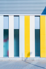 Direct view of colorful striped elevation on building