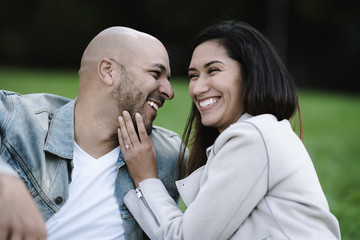 Close up of smiling couple sitting outdoors