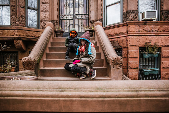 Portrait of brother and sister sitting on stairs