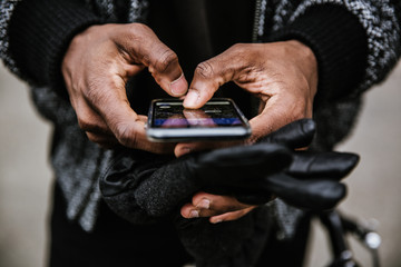 Midsection of man using smartphone