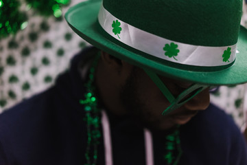 Close up of man wearing green hat and goggles