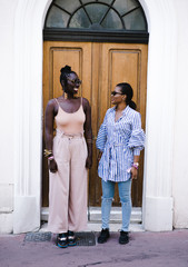 Women standing against door