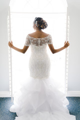 Rear view of bride standing in wedding dress