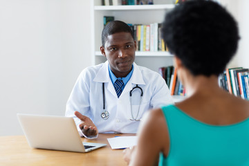 African american doctor explaining diagnosis to female patient
