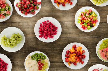 Fruit diet. Fruits on a plate on a wooden background. Healthy food