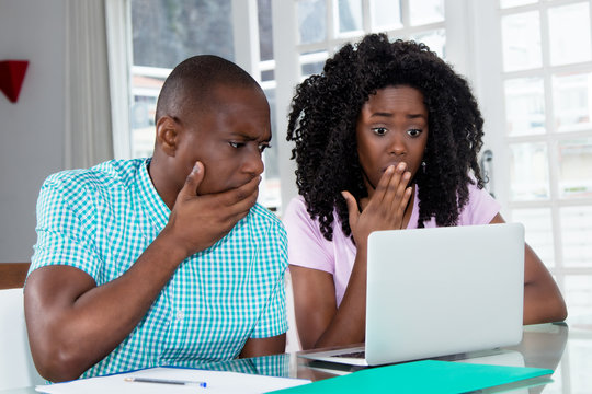 African american couple shocked about computer virus and identity theft