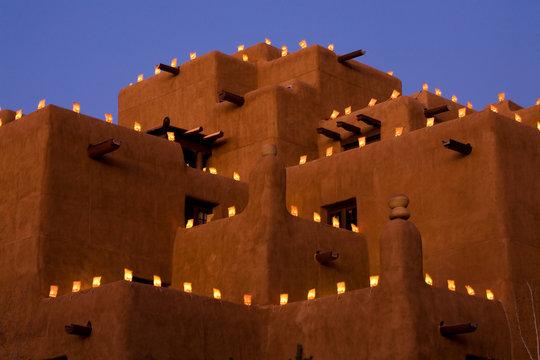 Farolitos illuminate the edges of a classic Adobe in Santa Fe, New Mexico.
